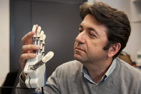 Biomedical engineering is the integration of biology, medicine and engineering to develop systems and devices to improve health care. Pictured: Silvestro Micera, a neural engineer, led a team that developed a bionic hand that can feel.  Credit: EPFL / Hillary Sanctuary
