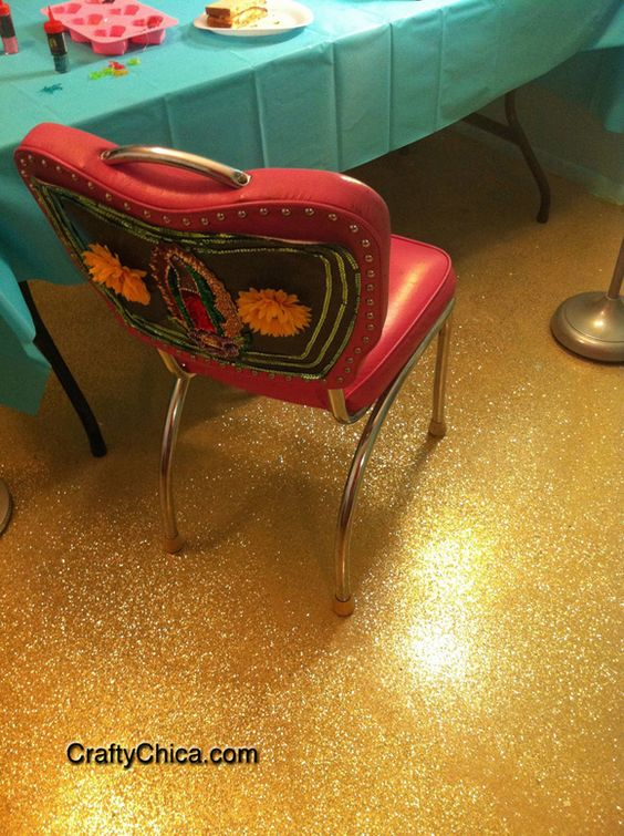 Using a home garage floor epoxy kit, a large amount of craft store glitter, and five coats of polyurethane as a sealant, you too can have a sparkle-tastic floor