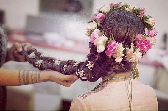 Bridal Inspiration ✨ #repost @shaadisaga #shaadisagapicks - Braid with floral details is perfect for a mehendi event! Tell us what you think about it?  Picture courtesy: @aanalsavaliya . . . . . . #floral #hairstyle #mehendi #mehendilook #wedding #weddingevents #weddingfashion #weddinginspiration #shaadisaga #instagood #weddingphotography #indianbride  #instadaily  #weddingphotography #lehenga