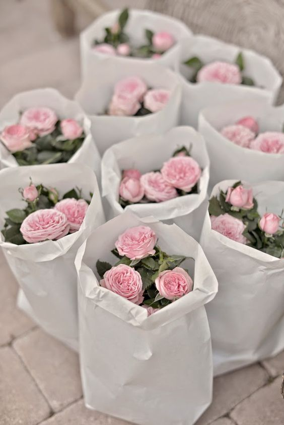 Great wedding favours, small pot of mini roses, maybe in your wedding colour?