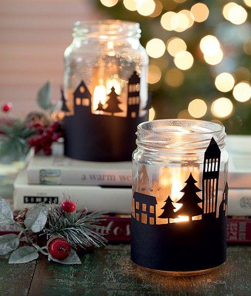 Luminárias feitas com potes de conserva e desenhos recortados no papel-cartão: