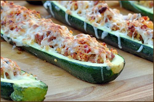 One of 5 ways to use zucchini.   image for Italian Stuffed Squash.  STUFFED In Italian Stuffed Squash, halved zucchini are the perfect carriers for a filling of couscous, Italian sausage, tomatoes and gooey mozzarella cheese. Add a glass of wine, and you have the perfect summer supper.: Italian Stuffed, Food Ideas, Yummy Food, Yummy Recipe, Stuffed Squash, Food Drink, Sausage Stuffed Zucchini, Recipe Book