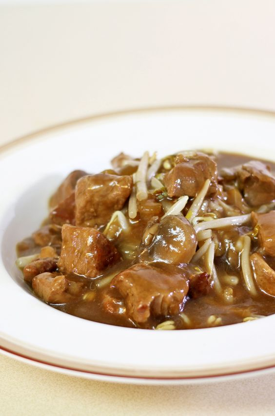 Grandma's Chop Suey - Tender pieces of pork, celery, onions, mushroom and water chestnuts served over rice. Recipes Food and Cooking