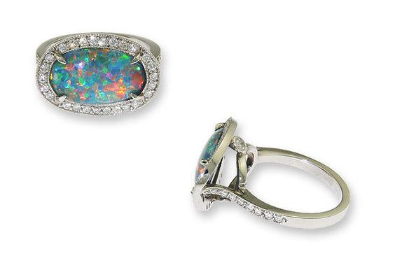 my dream engagement ring: 'cause lawd knows i love black opals! :)