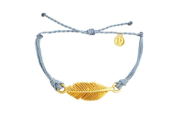 """Our gold """"Feather"""" charm is the perfect bracelet to add to your Pura Vida collection. Let the wind guide you with this blue and gold bracelet; a classy combination for the free spirit in all of us. Th"""