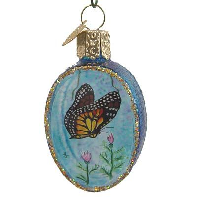"Butterfly Inside Art Christmas Ornament 99621 Merck Family's Old World Christmas - Retired Ornament made of mouth blown, hand painted glass, measures approximately 2"" to top of crown."