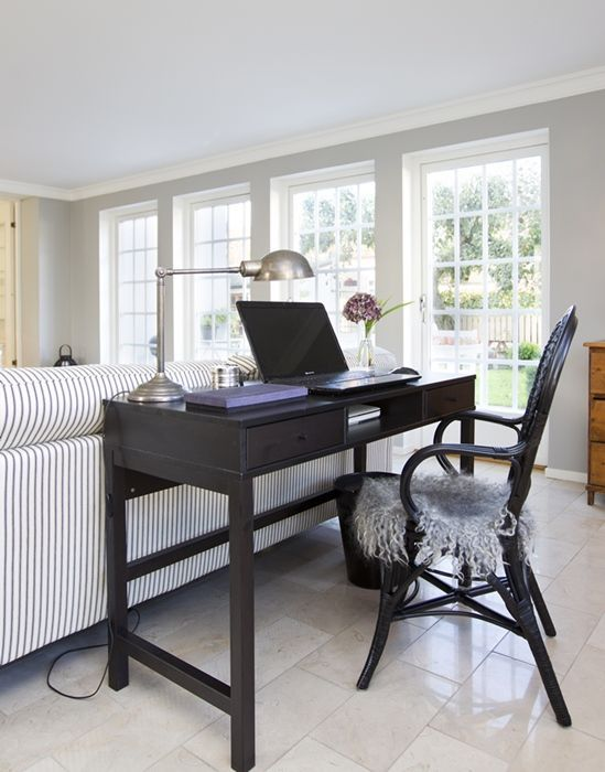 A Vintage Black Desk And Chair Differ In Style And Stand Out From A Rustic Space It Help Desk In Living Room Living Room Office Space Living Room Office Combo