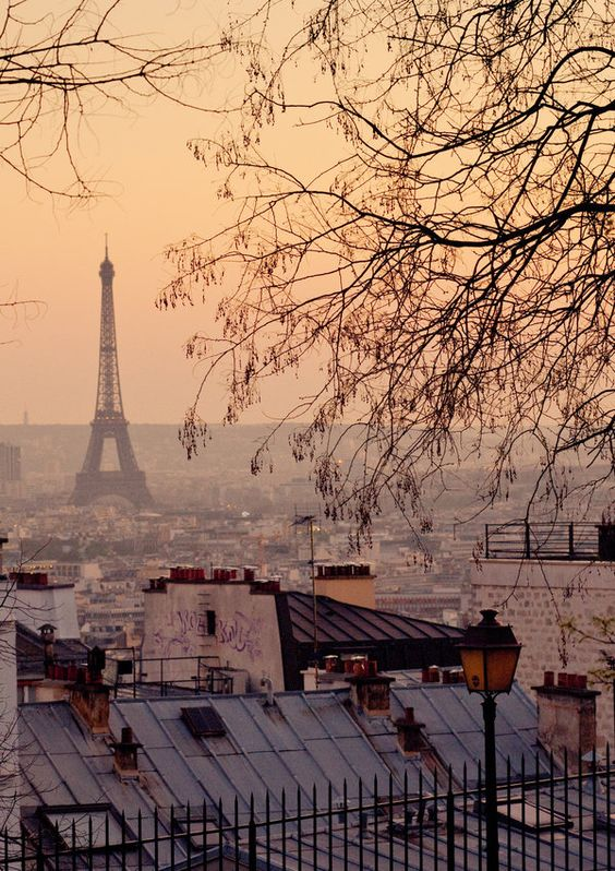 The Eiffel Tower from Montmartre. How God and humans conspire: God creates the light, we build the city to celebrate it.