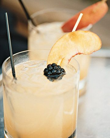 White-peach sangria garnished with blackberries and peaches