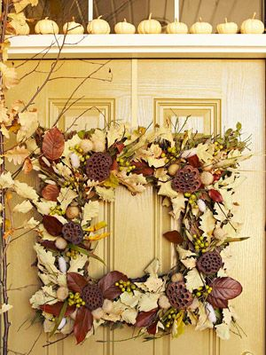 wreath for autumn with white pumpkins