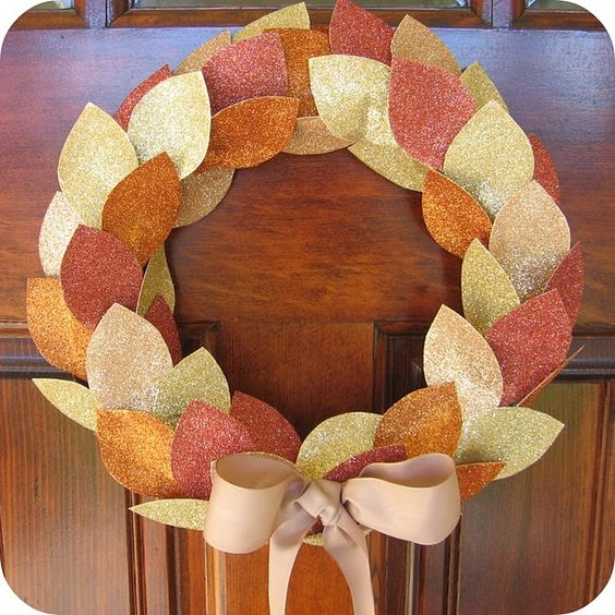 Glittered cardstock cut into leaf shapes, glue on wreath.
