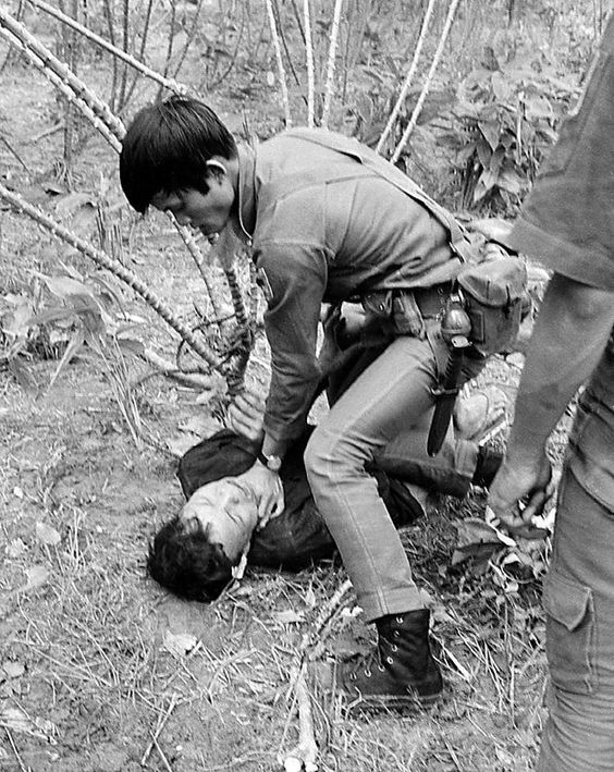 A South Vietnamese soldier chokes a Viet Cong suspect during an interrogation about the disappearance of French journalist Michele Ray, at Ngoc An village, Jan. 22, 1967. Ray was released by the Viet Cong about two weeks later. (AP Photo/Henri Huet) ~ Vietnam War