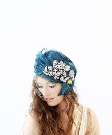 A teal feathered headpiece...so perfect for a vintage theme wedding! up to no good from http://shopbando.com/up-to-no-good/prod/483?rc=1  Photo Credit: http://shopbando.com