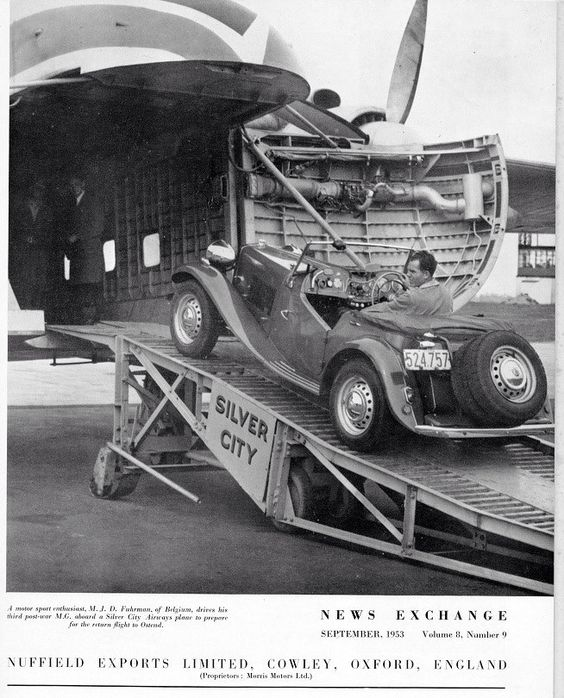 TD with giant headlights, twin spares and rally equipment being airlifted to Belgium.