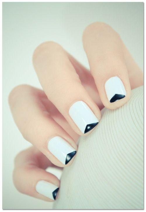 Reverse V-shaped French manicure. Nail art.