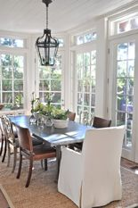 Zinc dining table and mix of chairs, jute rug