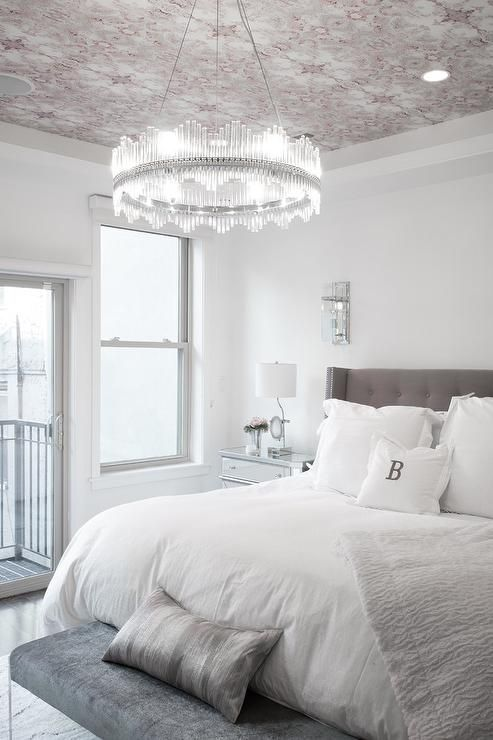 Elegant White And Gray Bedroom Features A Stunning Ring Chandelier