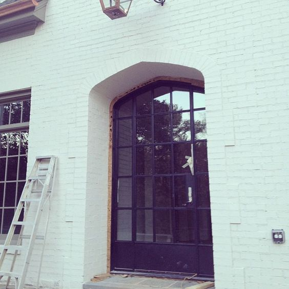 Limestone & Boxwoods - Instagram (@limestonebox) - Steel front door - Greg Busch Architect