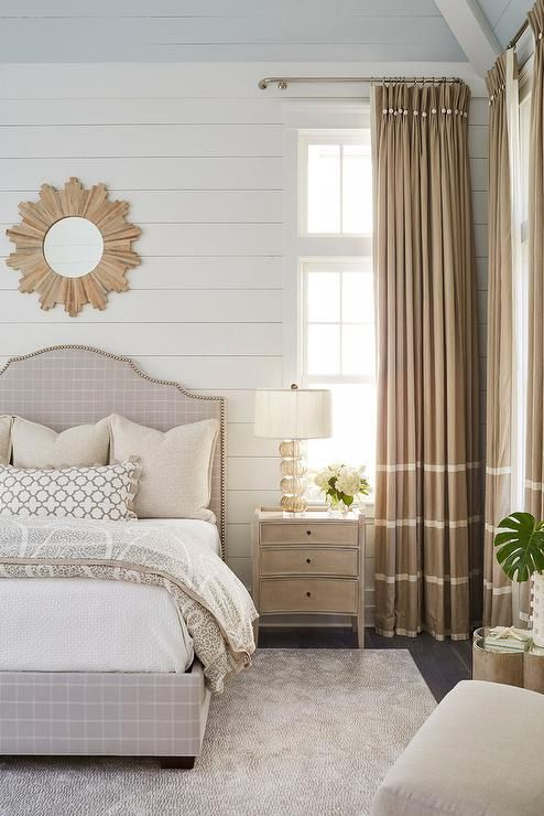 Welcoming White And Beige Cottage Bedroom Features A Wooden Sunburst Mirror Hung From A Shiplap Wall Above Bedroom Design Beautiful Bedrooms Master Home Decor