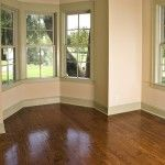 Beautiful hardwood floors and open windows add timeless style to any home.