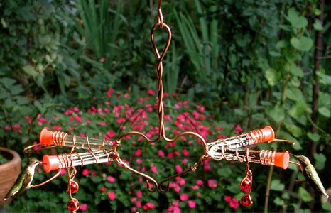 Victorian Love Birds Hummingbird Feeder . Features 2 paired tubes with perches., 4 feeding stations with glass beads. It lets 2 hummingbirds feed side by side. dimension:11 inches x 15 inches x 8 1/2 inches $39.99