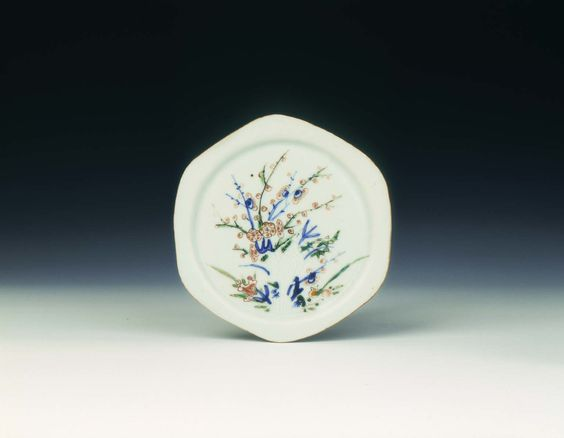 Flat polychrome saucer with rock and