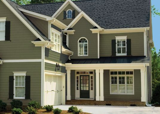 Dark exterior colors can make a home look smaller but more for Dark green exterior paint