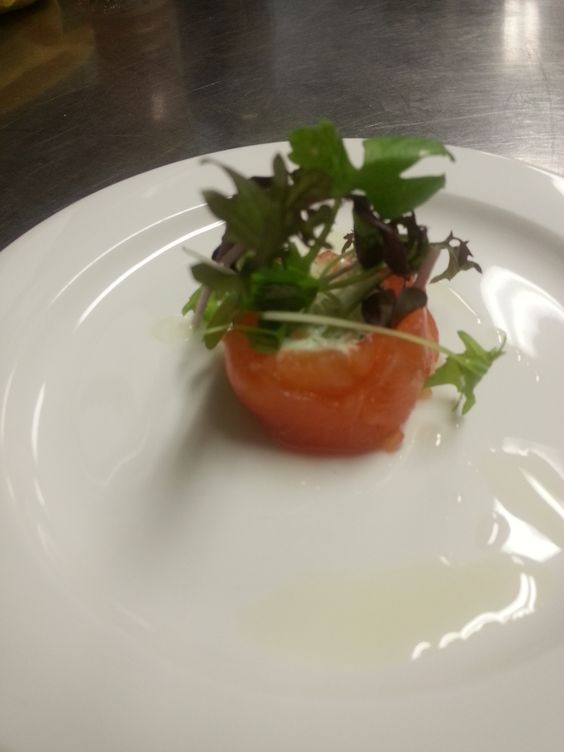 Smoked salmon, caramelized onion and goat cheese App with truffle oil