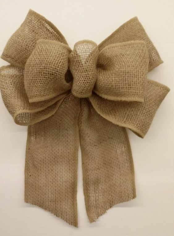 This bow is created with 4 wide wired burlap ribbon. Great for wreaths, swags, garlands and more! If you are looking to have a custom bow made for you, send me a message and I will help you make your vision come to life