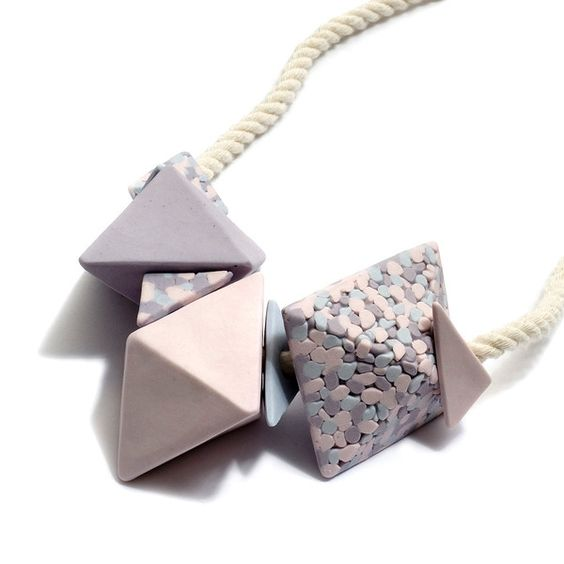 Jeweller Deirdre Hoban makes feminine geometric jewellery in porcelain that we adore. Here we have a large porcelain necklace with natural rope cord and sterling silver findings in lilac/light violet spots.