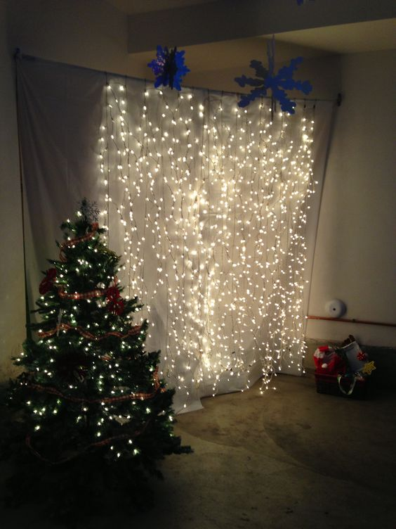 Christmas lights hanging against a back drop as a photo booth