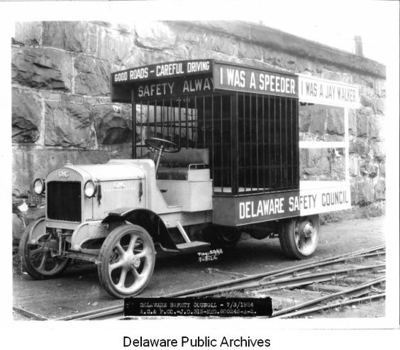 """GMC truck with jail cells in back. Manufactured for Delaware Safety Council. """"I was a speeder"""" """"I was a jay walker."""" 1924"""