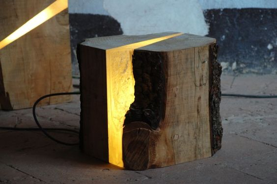 Italian designer Marco Stefanelli has taken objects which have reached the end of their life cycle, such as scrap wood from a sawmill, and given them a second chance, by combining them with cast resin embedded with LEDs.
