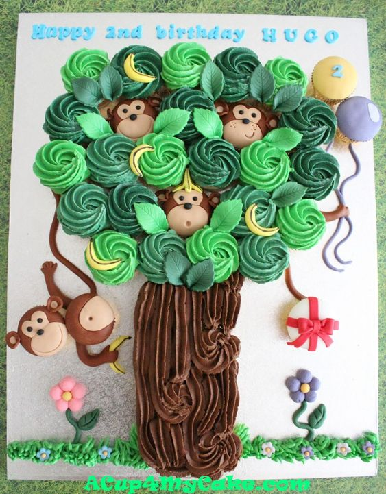 Cake made of cupcakes - great a idea for kids birthday because it makes serving lots of children much easier.