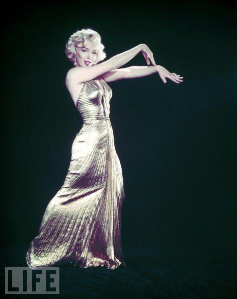 "Marilyn's Golden Age  Monroe wears a gold lame gown for ""Gentlemen Prefer Blondes."""