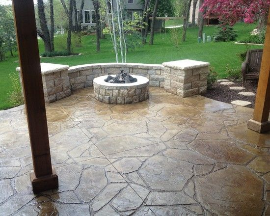 , Traditional Stamped Concrete Patio Ideas With Traditional Round Rock Fire  Pit Also Wooden Pillars Also Adorable Green Field And Garden Plants: Stu2026 ...