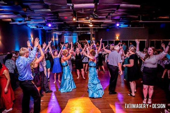Living it up on the dance floor in the Metropolis Resort Skybox room! Photo by [V]Imagery + Design. Eau Claire, WI