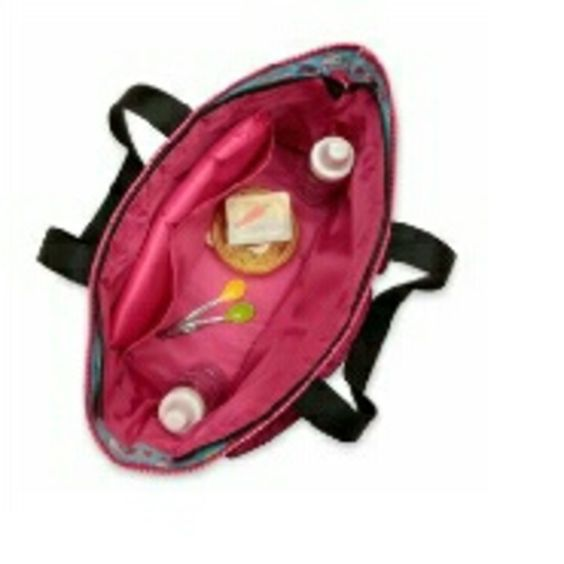 Hello Kitty Diaper bag Lots of outside compartments, main part zips close. Very roomy. Only flaw is a tiny hole in the bottom corner of the outside pocket! Hello Kitty Bags Baby Bags