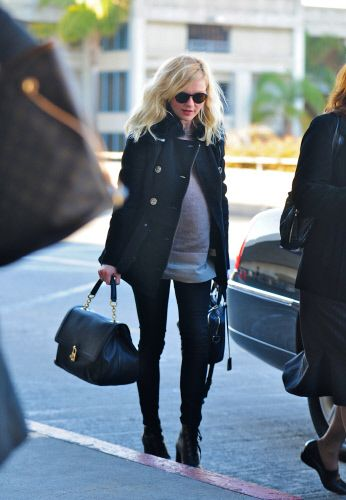 Kirsten Dunst carrying the Dolce Bag while departing LAX on January 21st, 2012
