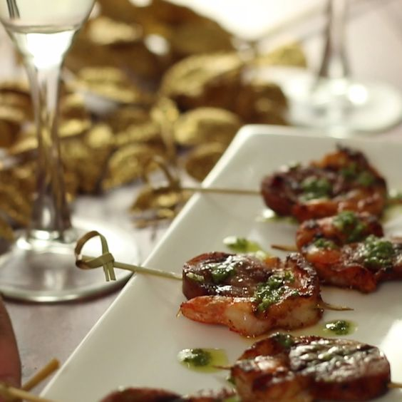 This New Year's Eve, spice things up! Have a glass of champagne in one hand, and many shrimp and chorizo skewers in the other.