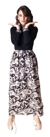 http://shop-stq.com/  Wednesday dress $ 78.00  Vintage Black dress with black and silver brocade cuffs and neck  Black and white brocade skirt tapers at the base for a fun, ballooned fit
