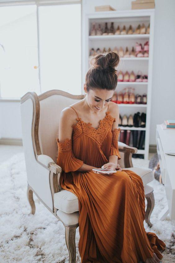 A glamorous draped and pleated lace dress.