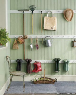 Peg-rail organizer - love the look of this with the wainscoting behind it. And this would look great carried all along the house wall, even behind the mudroom set-up. (There's a photo of it on this board)
