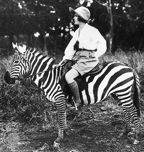 Girl riding a zebra