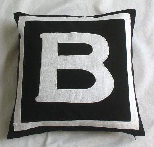Custom made monogram pillows -18 inches -black and white. $27.99, via Etsy.
