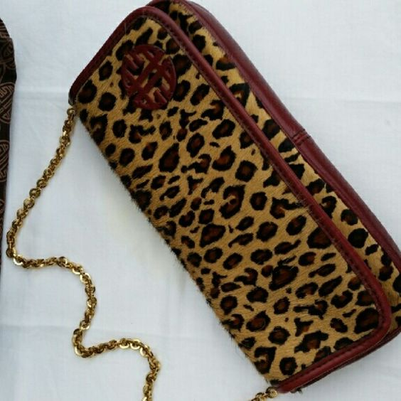 Antonio Melani Clutch Antonio Melani Calf Hair Clutch Animal print. Magnetic closure flap with gold chain. Carried only twice! Excellent condition. Comes with card and Dust bag. ANTONIO MELANI Bags Clutches & Wristlets