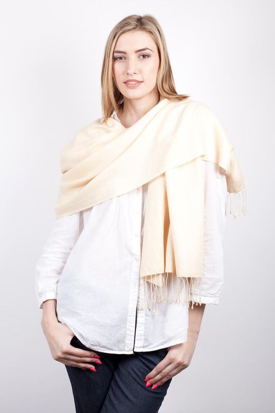 This is a cream wool and silk pashmina available with tassels or short-fringed.