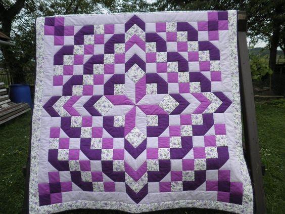 Purple and white.  it looks like 2 meters x 2 meters so the blocks should be approx 4 inches finished.