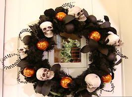 I need a new Halloween wreath for the front door...this just might be it!  Another option given on the site is using vampire teeth instead of skulls