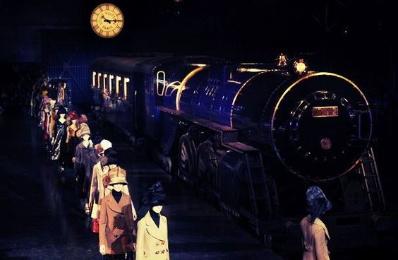 Louis Vuitton Fall/Winter 2012. The theme revolved around a steam engine train and there were attendants carrying the LV bags for the models. Very good concept!